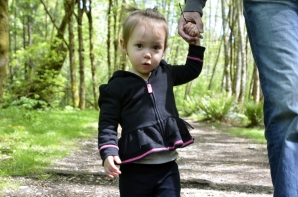 Luckily for us, Catarina loves the outdoors. And right now, she loves sticks - as you can see by what she is carrying in her left hand.