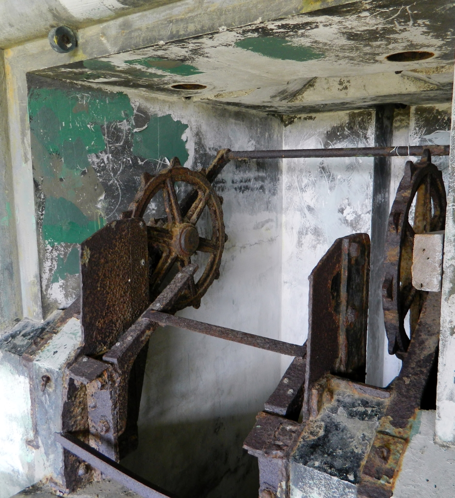 There are a lot of old, rusty mechanisms still in the buildings. Trying to guess what they were used for is half the fun of walking around. Maybe pulling up supplies from down below?