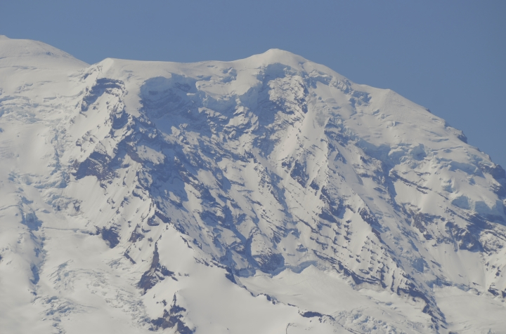 A close up shot of Mt. Rainier and what appears to be an avalanche of some sort. With the mountain just 10 miles away, our long lens afforded us extremely close shots. (Photo by Craig Craker)