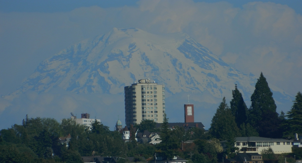 Mt. Rainier from Ruston Way in the summer. The hospital in the Hilltop neighborhood is often a photo subject in Tacoma. (Photo by Craig Craker)