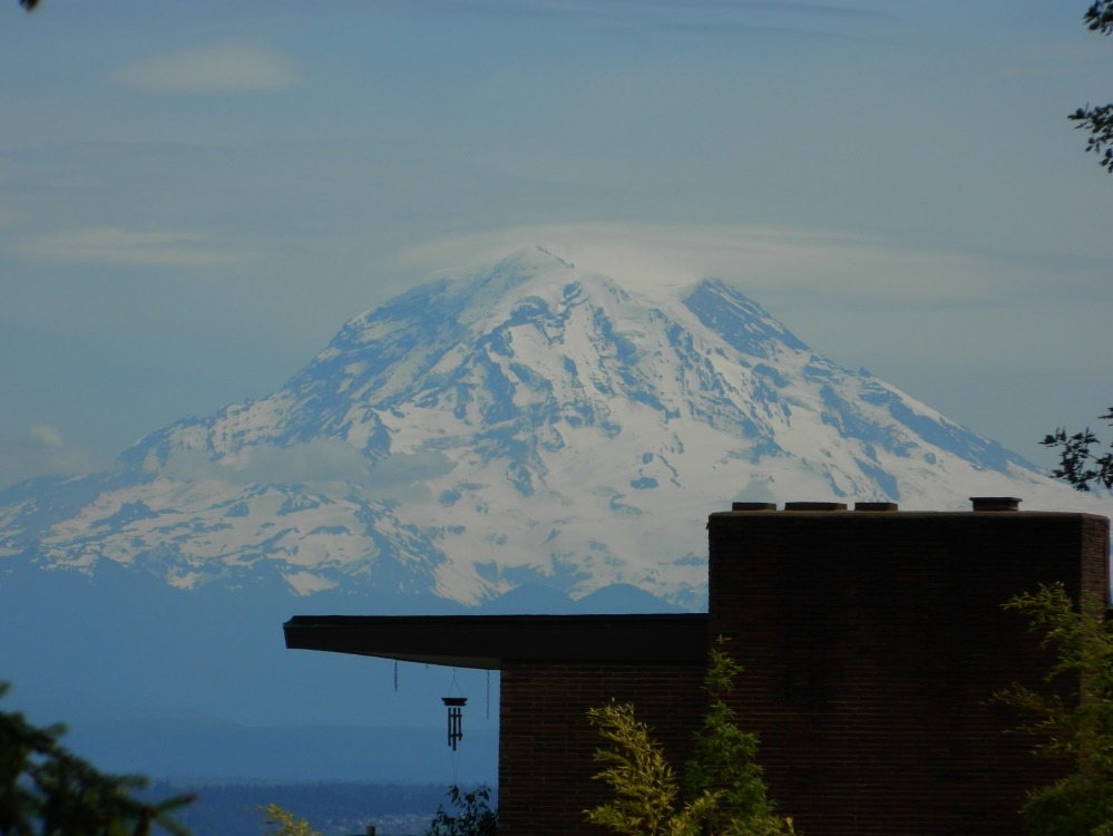 Mount Rainier looming over a house in the Stadium District in Tacoma in the summer. (Photo by Craig Craker)