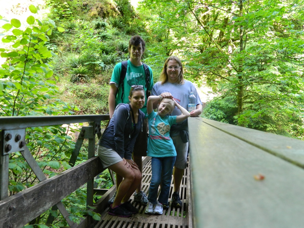 Photo of our hiking group, (from upper left going clockwise): Craig, Chris Gove, Gianna Gove and Veronica. We were posing on a bridge above Oneonta Creek on the Horsetail Falls loop trail in the Columbia River Gorge.
