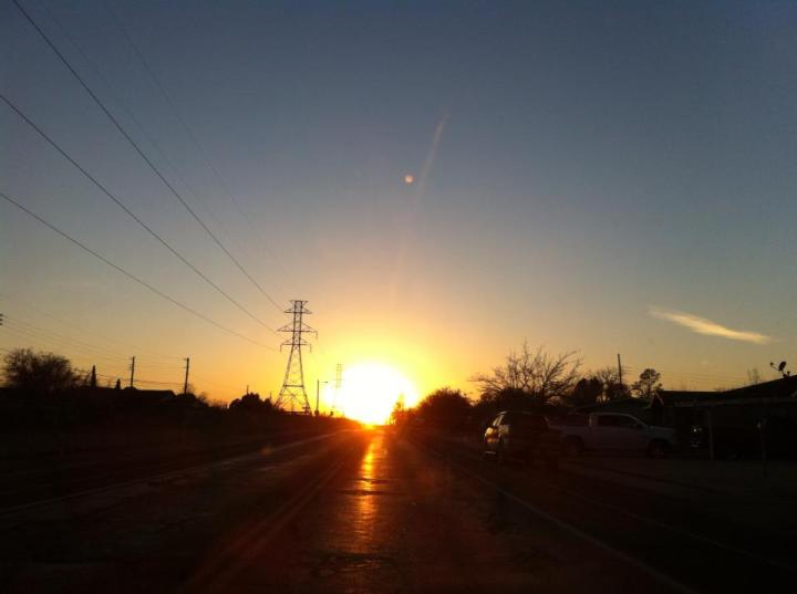 This was taken with my iPhone in Odessa, Texas. It is so flat in Odessa, that when the sun sets it appears you are driving straight into it. It is an amazing sight.