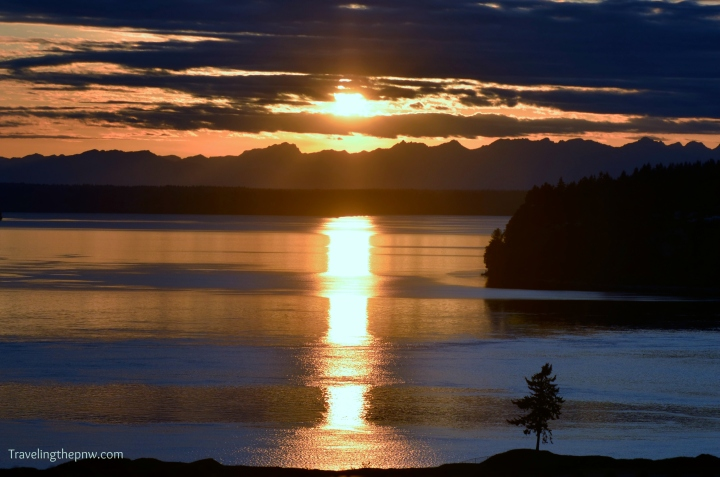 The sun gave a strange pillar of fire effect on the water for this shot from one of the overlooks next to Grandview Drive above Chambers Bay Golf Course in University Place.