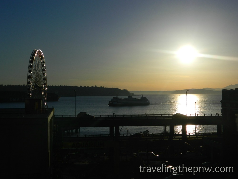 This is stretching it a bit as far as sunsets go, as the sun is pretty high still. But it is still one of my favorite photos. I shot this from the overlook near the corner of Union and 1st Avenue in downtown Seattle.If only the giant tanker ship wasn't behind the Great Wheel ...