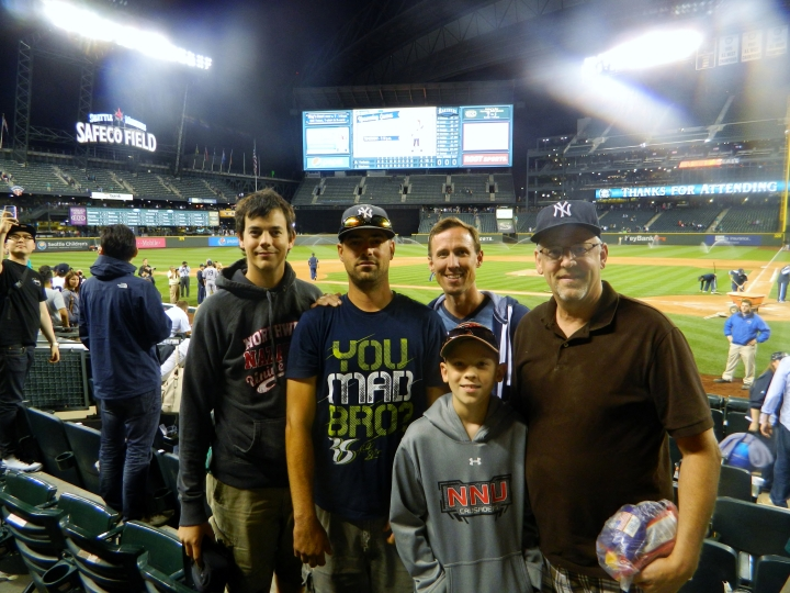 After watching the Yankees beat the Mariners, we posed for a photo near the Yankees dugout in 2014. From left: Craig Craker, Mick Craker, Dustin Metcalf (back), Andrew Metcalf and Randy Craker. The Craker men have been going to games since the early 1980s together, thanks to Randy's love for baseball. It is a passion he passed down through the generations.