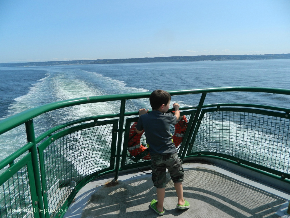 Our nephew Emmett showing no fear while standing at the back of a Washington state ferry motoring through the Puget Sound.