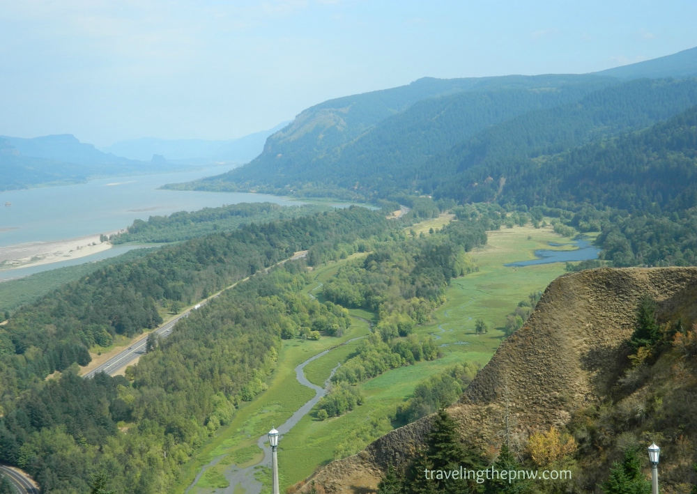 The views from the Vista House are too good to be true. Here a lush valley and the mighty Columbia River can be seen looking upstream.