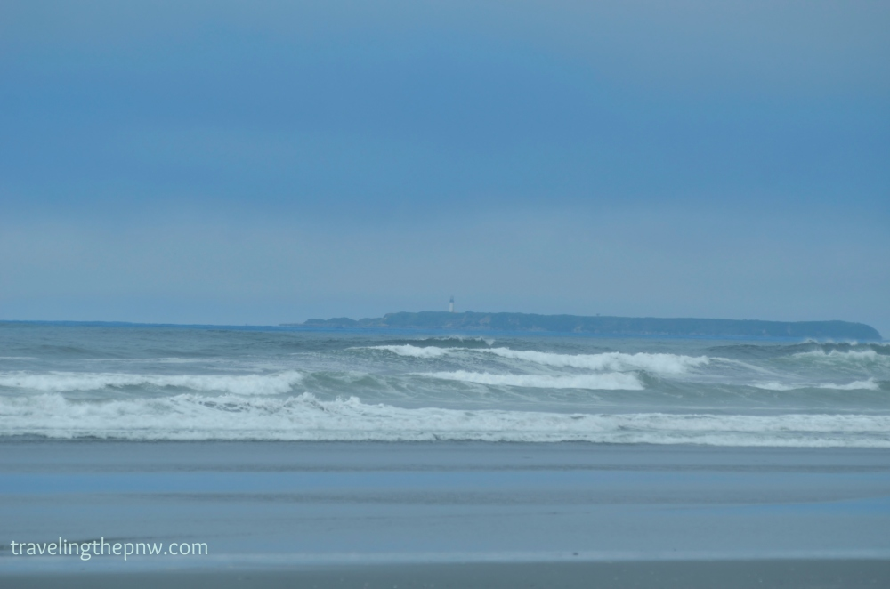 The Destruction Island lighthouse is barely visible in the distance. Gray whales migrate between the island the beach, offering views up to campers at certain times of year.