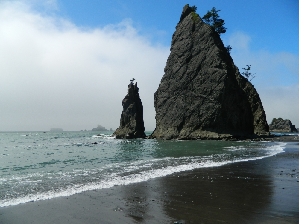 As the clouds rolled back at Rialto Beach, they offered an amazing blue sky which augmented the arrowhead looking sea stacks near the Hole in the Wall.