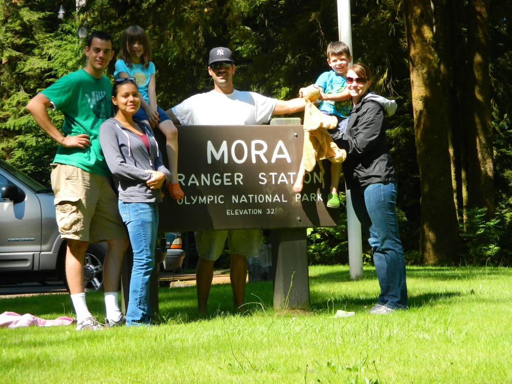 Criag, Veronica, Eleanor, Mick, Emmett and Kim pose for the camera at the entrance to the Mora Campground, near Rialto Beach on the Olympic Peninsula.