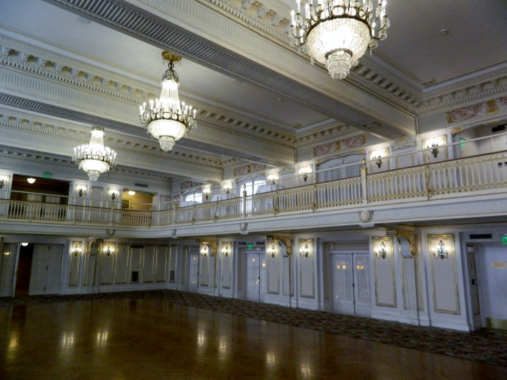The Maria Antoinette Ballroom, which has three massive chandeliers and a beautiful balcony ringing the room.