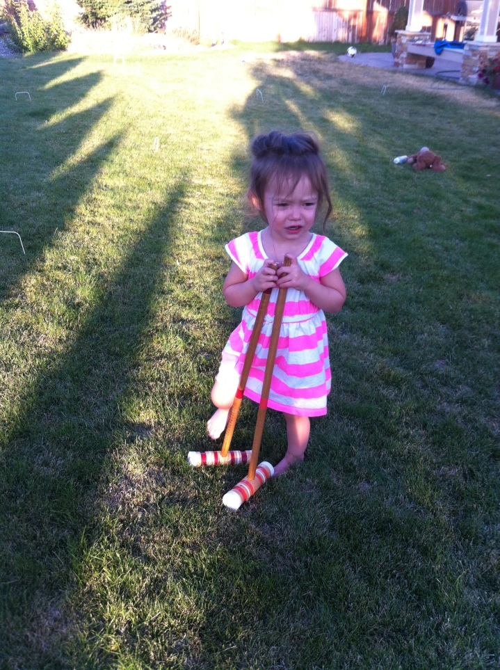 Catarina getting in some early practice on the croquet course.