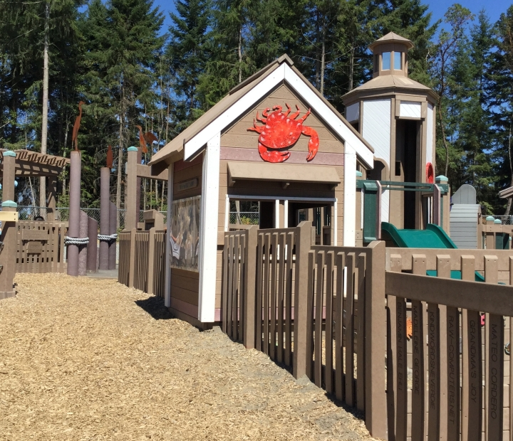 The playground has a fun seafaring theme complete with a lighthouse and a crab shack.