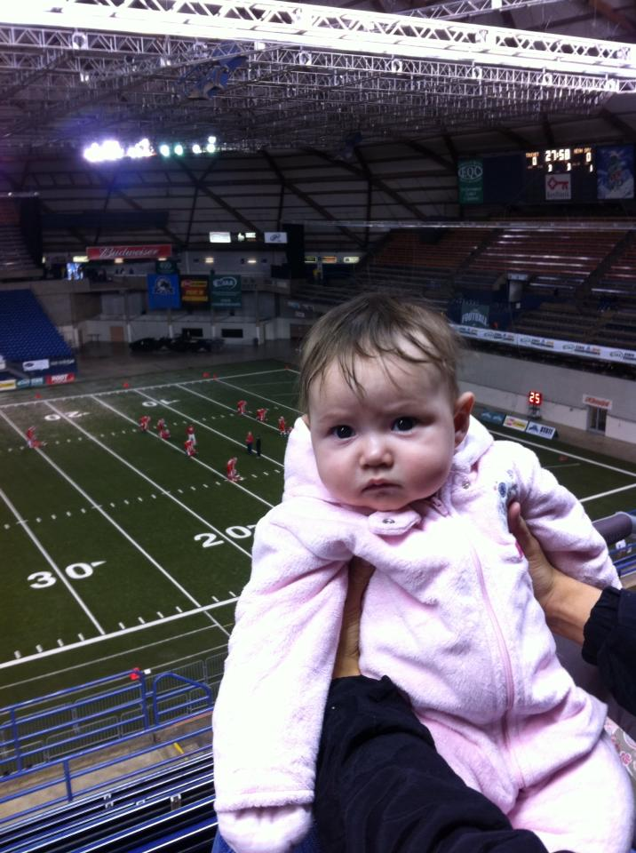 Even journalists' children are subject to events. Catarina at her first football game, the Class 1B eight-man state championship in 2013 at the Tacoma Dome.