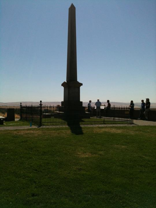 The memorial obelisk on top of a hill on the mission's property.