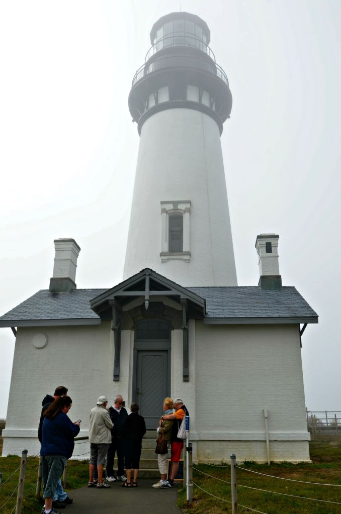 The Yaquina Head Lighthouse shrouded in fog.