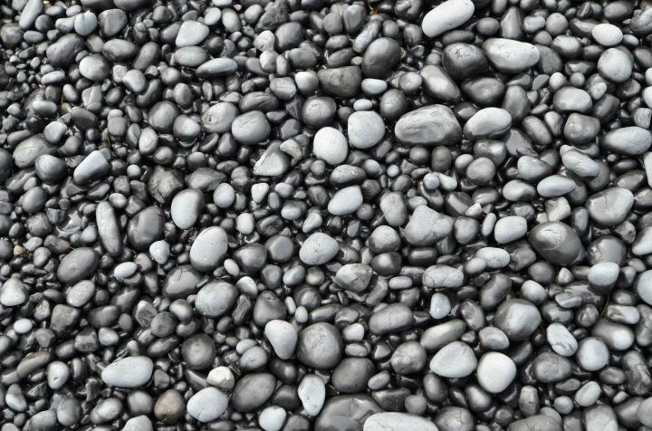 The black rocks that make up Cobble Beach.