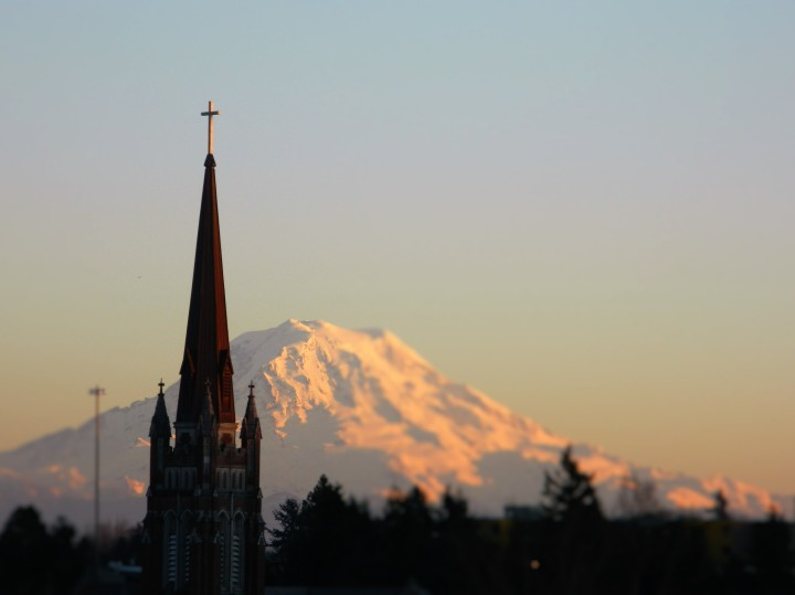 The Holy Rosary Church of Tacoma with Mt. Rainier looming in the background.