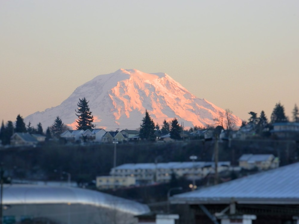 Mt. Rainier looms over downtown Tacoma during the first sunset of 2016.