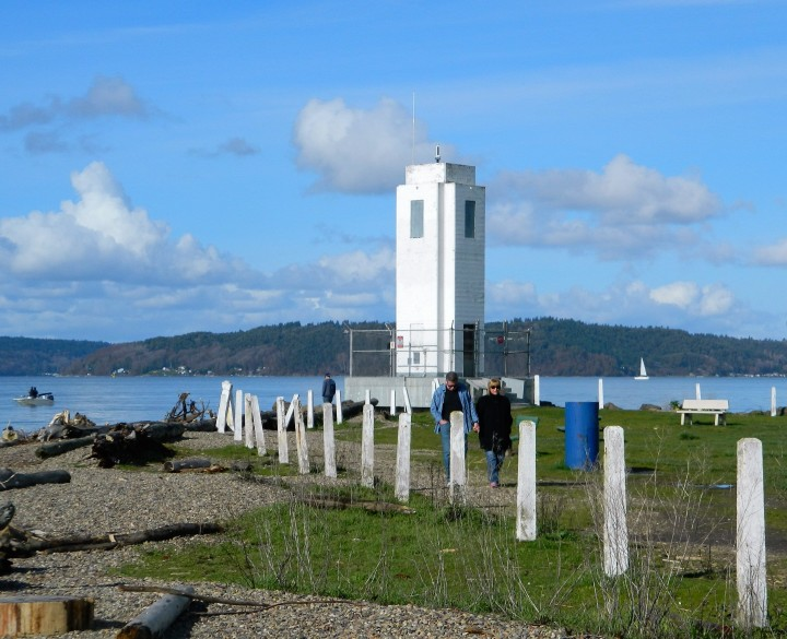 The lighthouse stands guard at the end of Browns Point helping direct the massive container ships headed to the Port of Tacoma.