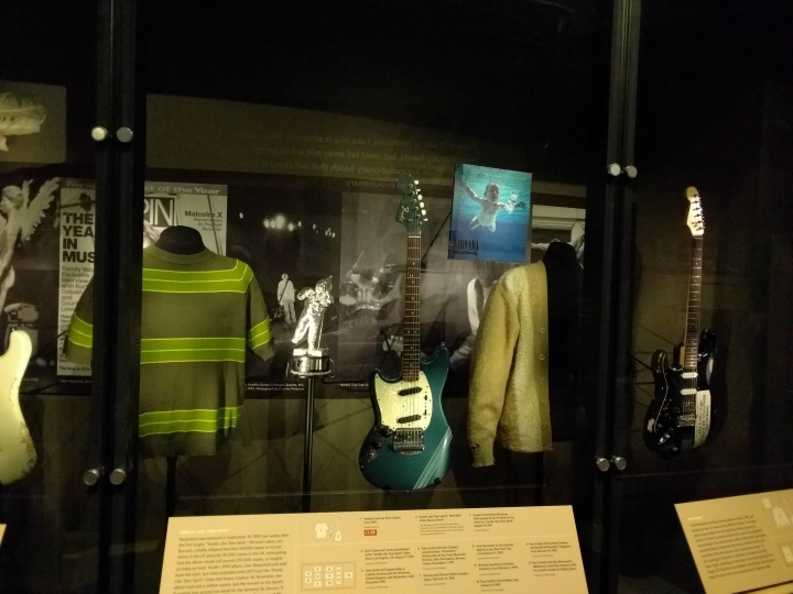 Some of the Nirvana exhibit. The classic sweaters that Kurt Cobain wore are on display.