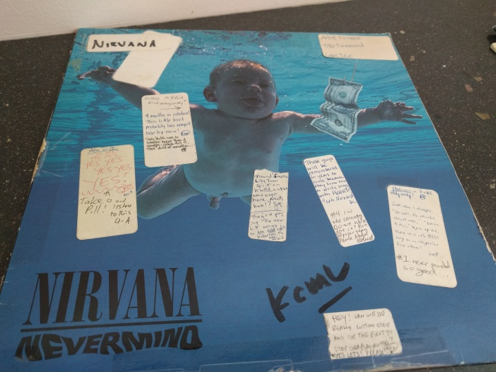 Nirvana's Nevermind album with KEXP DJ notes stuck to it.