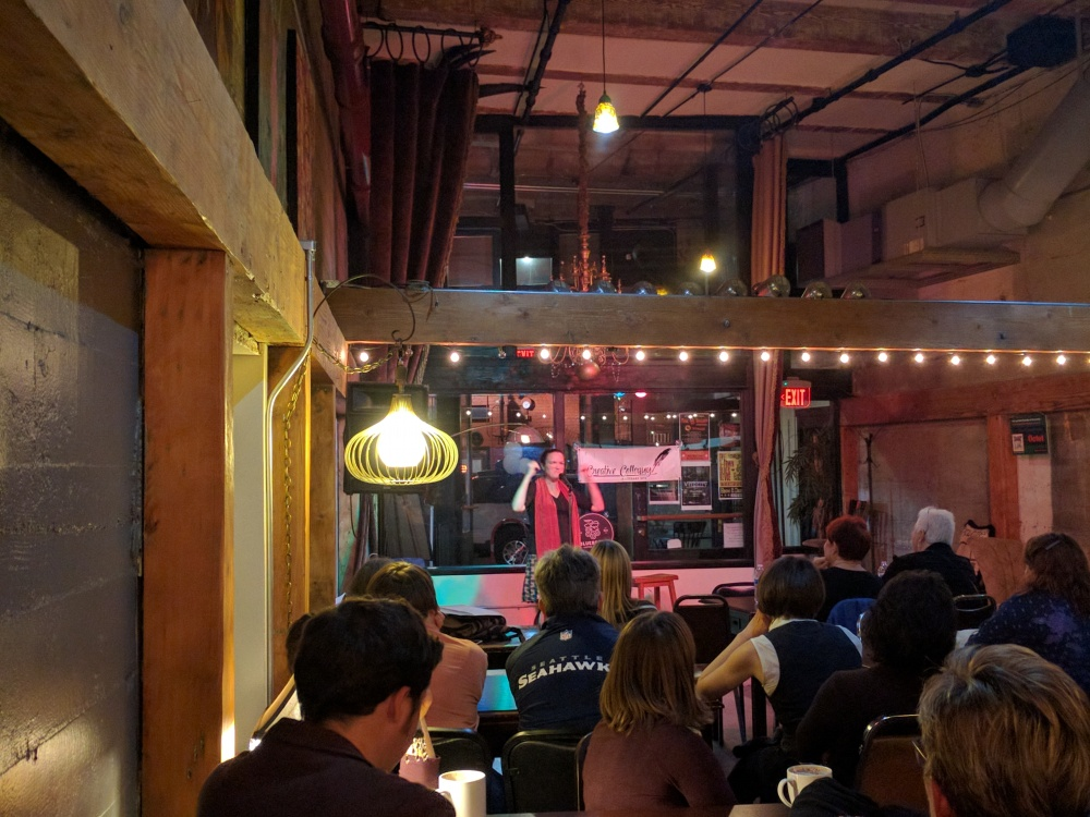 Drunken Telegraph co-founder Megan Sukys talks about her recent discovery into what makes a place home during the Creative Colloquy Crawl at B Sharp Coffeehouse in Tacoma.